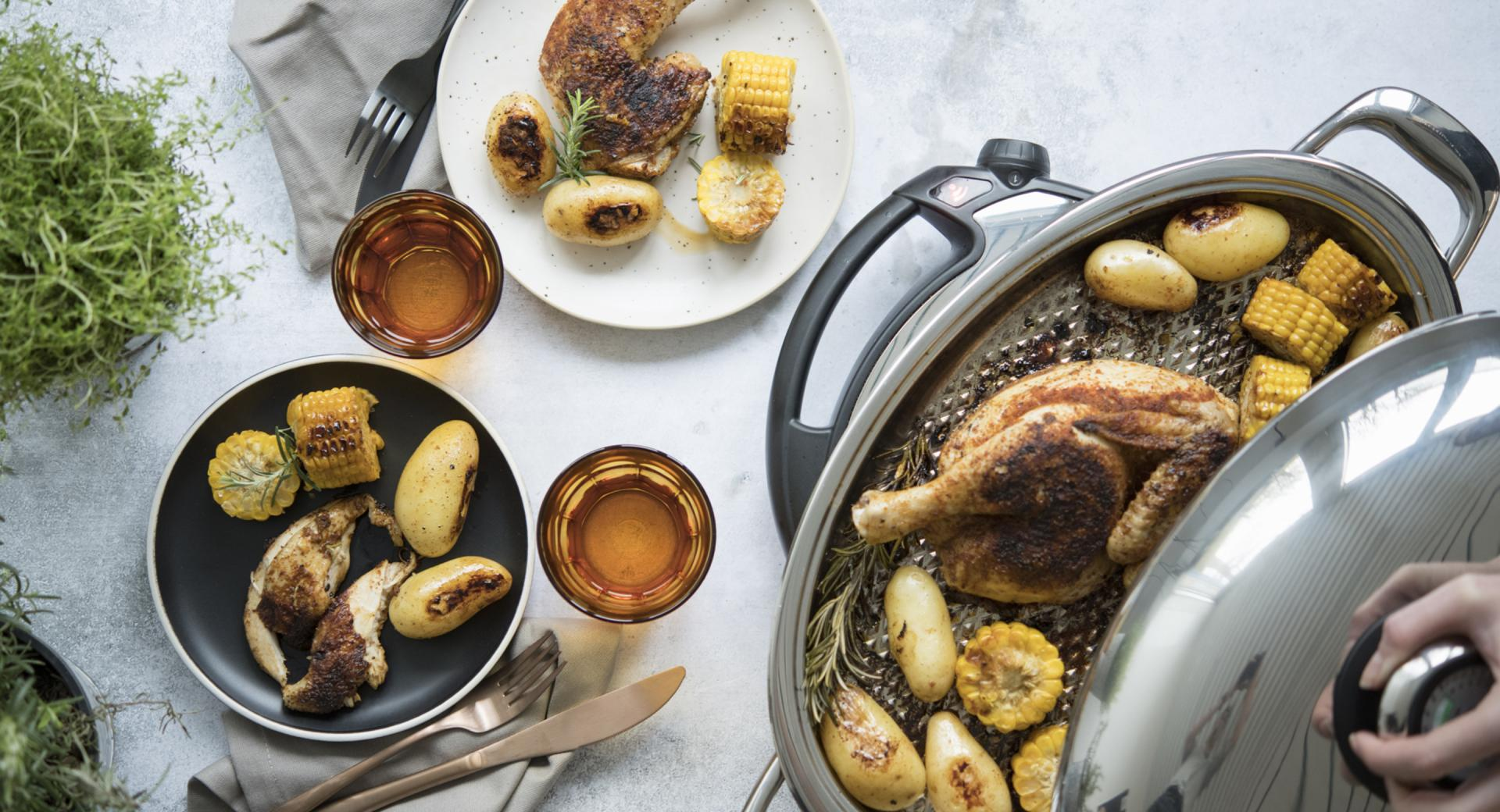 Broiler with potatoes and corncob