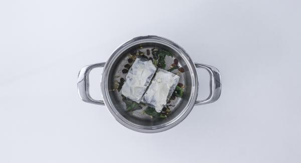 Place cod in pot on top of spinach, with aioli side facing upwards.
