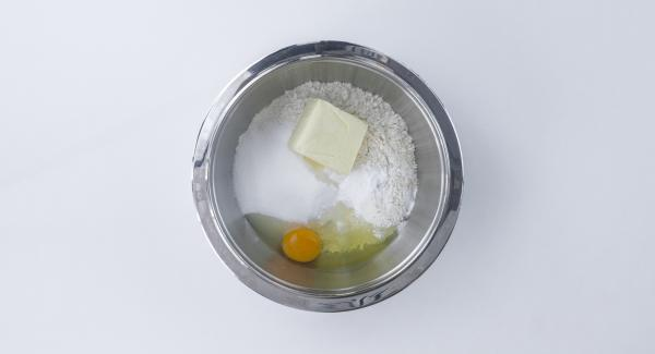 Mix all ingredients in a bowl until completely blended, forming a sticky dough.