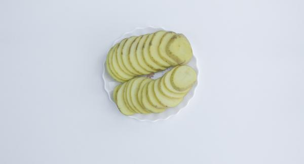 Cut onion into strips and potatoes into slices.