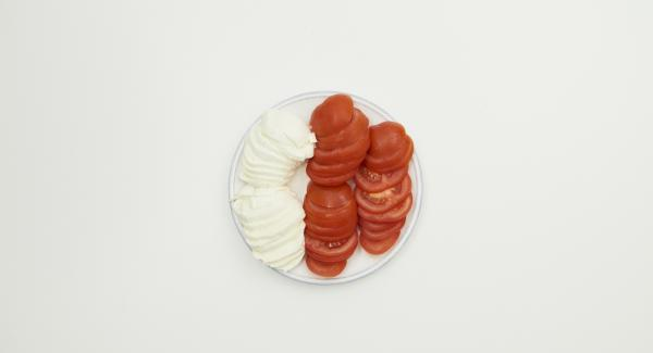 Clean tomatoes and and cut them into slices, also cut mozzarella into slices.