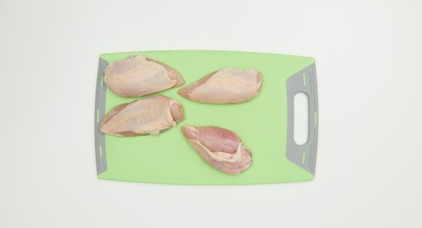 With the chicken breasts, carefully with the fingers over an opening, separate the skin from the meat and fill in garlic olive mixture, press firmly.