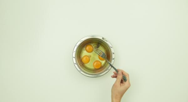 Break 4 eggs in a bowl and whisk with a fork. Season with salt and pepper if you like.