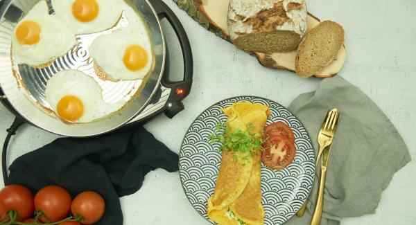 Break eggs in it and roast according to taste. Season with salt and pepper.
