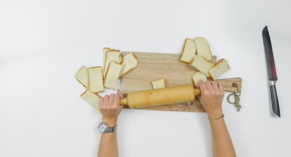 Halve bread slices. Roll flat with a rolling pin.