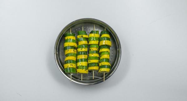 Spear zucchini slices alternately on four wooden skewers and place in a Softiera insert.