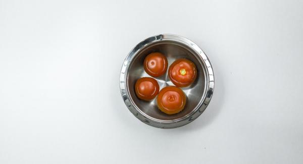 Pour boiling water over the tomatoes, quench, skin and cut into eighths.