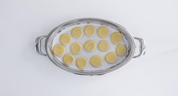 Place baking paper on the cold Oval Griddle and position future biscuits on it.