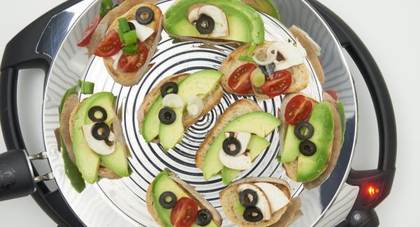 After turning, spread the avocado slices on the roasted bread slices and serve with any garnish.