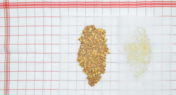 Place brittle mass on one half of the baking paper, fold the second half of the paper over it. Roll out brittle with a rolling pin as flat as possible. Let cool down.