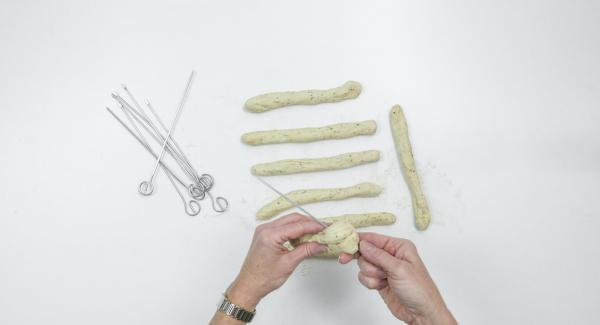 Wrap the dough in a spiral around the skewers, press the ends well. Cover and leave to rest for 5 minutes.
