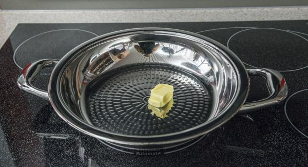 Put butter in a HotPan and switch on the stove at the highest level. As soon as the butter starts to foam, swirl it in the HotPan and place in the potato burger.