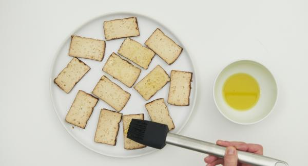 Cut the tofu into four large or several small slices and brush with the remaining oil.