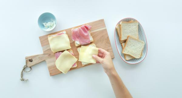 Smear four slices of toast with cream cheese or spread each with a slice of cheese. Spread them with cress, sprouts or salad leaves. Cut the tomato in thin slices and put one on each toast.