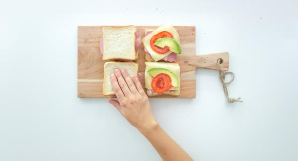 Place the remaining four slices of toast on top and press them together.