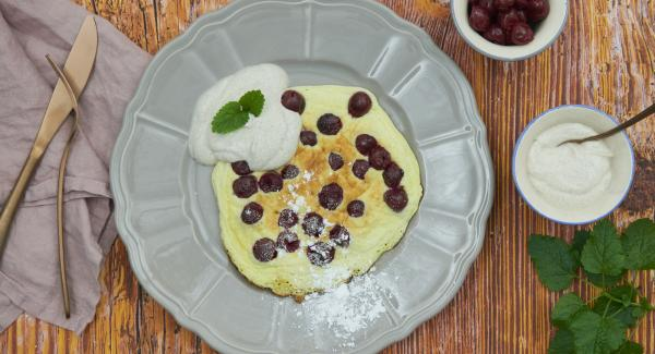 Dust the finished omelets with icing sugar and serve warm with yoghurt.