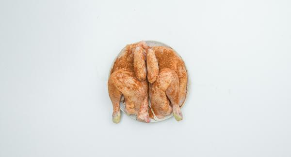 Halve chicken in two pieces. Rub from all sides with the spices and marinate for about 2 hours.