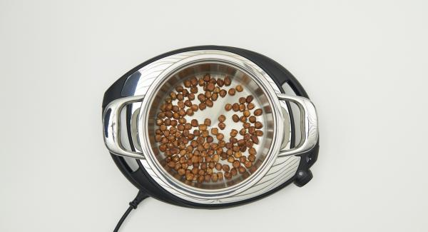 As soon as the Audiotherm beeps on reaching the roasting window, place nuts in the pot and place pot in inverted lid.