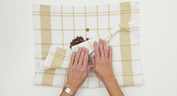 Place the nuts on a clean tea towel, remove the brown skin of the nuts by rubbing them vigorously.