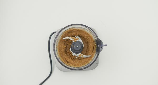 Chop the nuts very finely in a blitz chopper of a food processor: if possible, until a creamy puree is obtained.