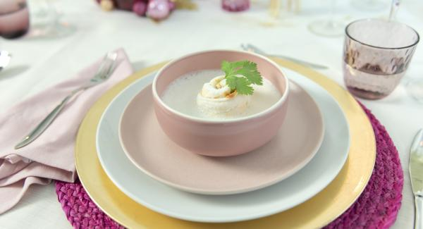 Coconut soup with peanut fish rolls